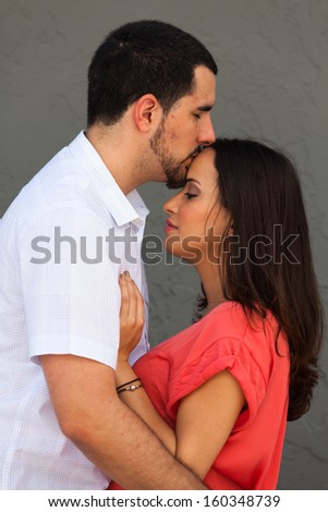 Young couple in a loving pose. - stock photo