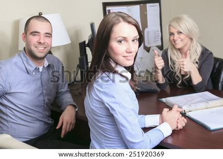 Young couple in a meeting - insurance or bank for investments - stock photo