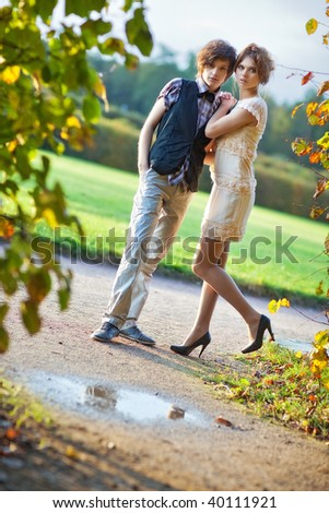 Young couple in a park. Camera angle view. - stock photo