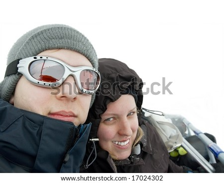 Young couple in a ski lift