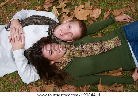 Young couple in an autumn forest picnic area - stock photo