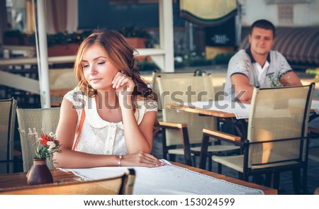 young couple in an open-air cafe - stock photo