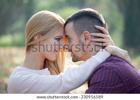 Young couple in autumn park - stock photo