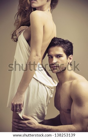Young couple in bedroom - stock photo