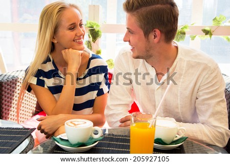 Young couple in cafe enjoying the time in holiday - stock photo