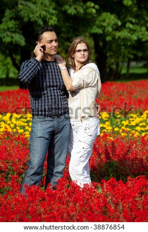 young couple in flowering park - stock photo