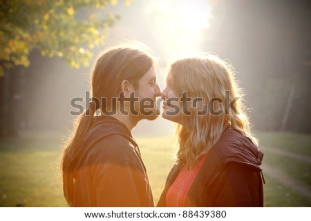 Young couple in foggy autumn morning - stock photo