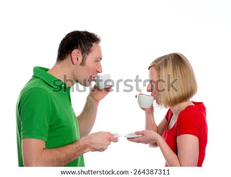 young couple in front of white background drinking coffee - stock photo