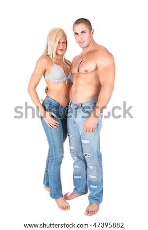 Young couple in jeans standing and posing, studio shot - stock photo