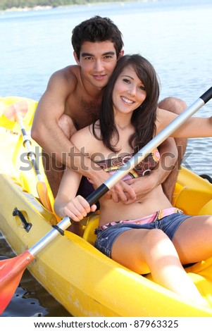 Young couple in kayak - stock photo