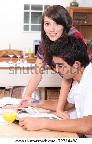 Young couple in kitchen before work - stock photo