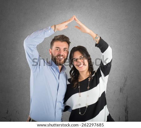 Young couple in love and home projects - stock photo
