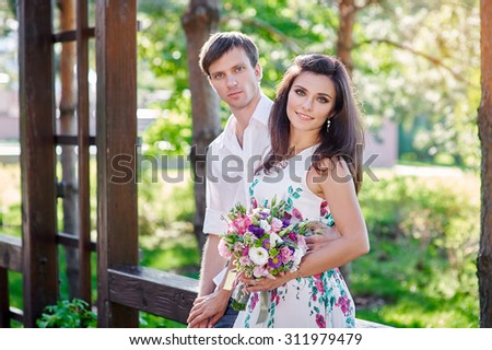 Young couple in love are smiling and looking at each other.