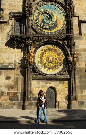young couple in love at Prague's astronomical clock - stock photo