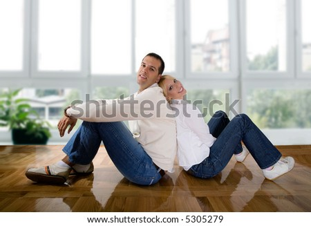 young couple in love at the empty house - stock photo