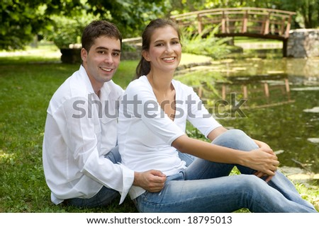 young couple in love at the park - stock photo