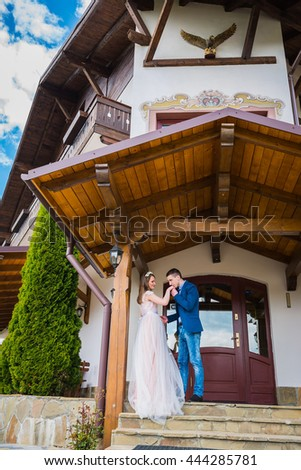 Young couple in love, Attractive man and woman enjoying romantic date, groom kissing the hand of bride - stock photo