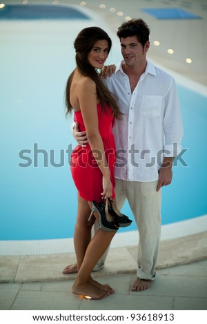 Young couple in love by the pool