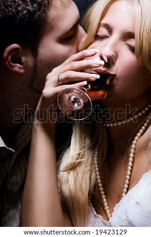 young couple in love celebrate with wine - stock photo