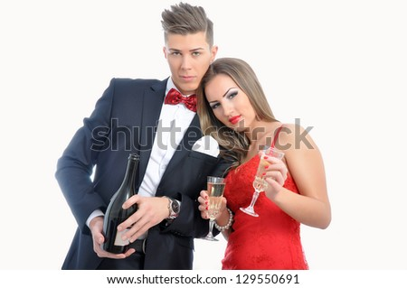 Young couple in love  celebrating with champagne - stock photo