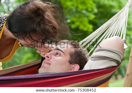 Young couple in love - detail of girl looking to eyes of her boyfriend - stock photo