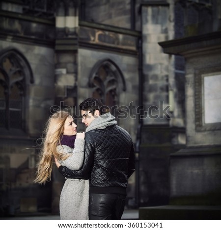 Young couple in love embrace one another outdoors  - stock photo