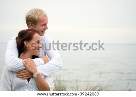 young couple in love embracing - stock photo