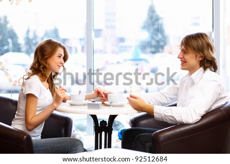 Young couple in love having a date in restaurant