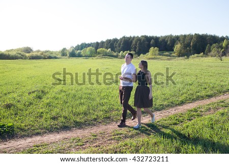 young couple in love having fun and enjoying the beautiful nature - stock photo
