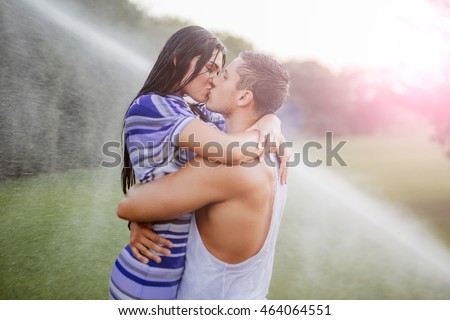 young couple in love having fun and enjoying the beautiful nature.Young couple in the rain
