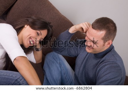 young couple in love having fun at home