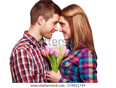 Young couple in love holding a bouquet of tulips. The concept of Valentine's Day
