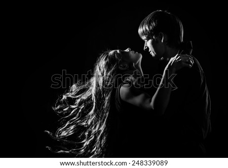 Young couple in love hugging each other, black and white photo - stock photo