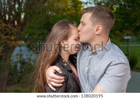 Young couple in love. Kissing - stock photo