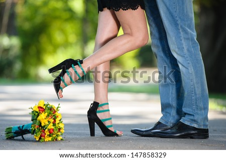 Young couple in love kissing - stock photo