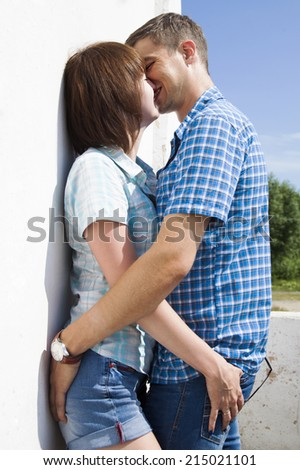 Young couple in love kissing and hugging each other outdoor  - stock photo