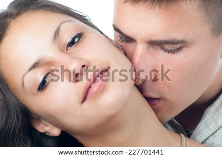 Young couple in love kissing isolated on white. - stock photo