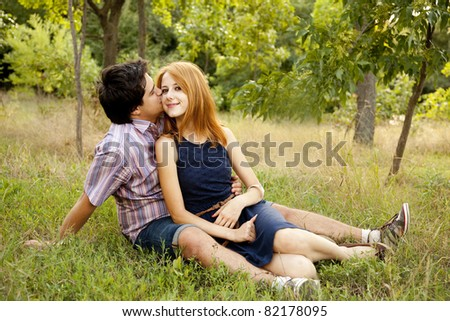Young couple in love kissing outdoors.
