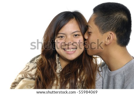 young couple in love, kissing, studio shot,