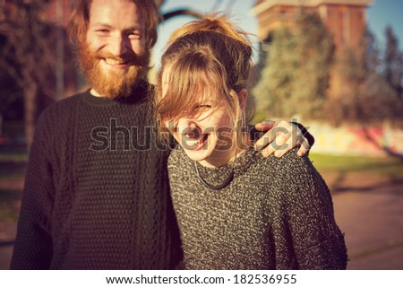 young couple in love lifestyle outdoor at the park