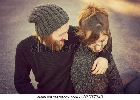 young couple in love lifestyle outdoor using tablet at the park