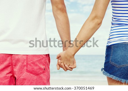 Young couple in love on the beach - stock photo