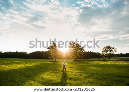 Young couple in love outdoor. - stock photo