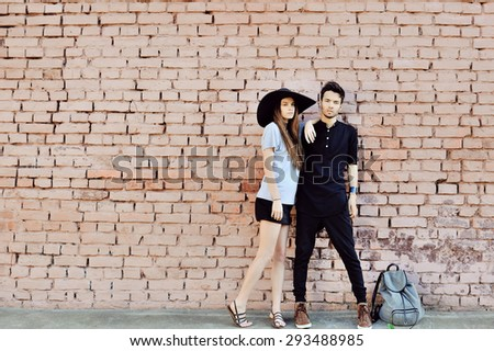 Young couple in love outdoor - full length portrait  - stock photo