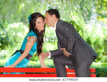 Young couple in love outdoor in a park - stock photo