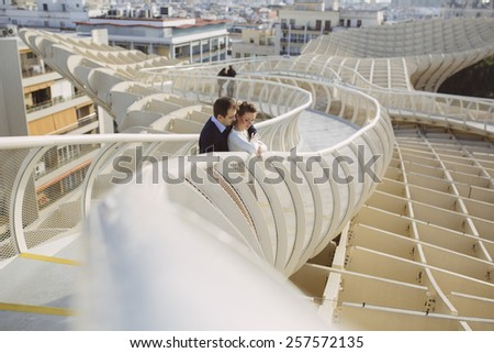 Young couple in love outdoor in Metropol Parasol, Seville - stock photo