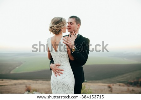 Young couple in love outdoor. Stunning sensual outdoor portrait