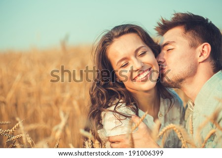 Young couple in love outdoor.Stunning sensual outdoor portrait of young stylish fashion couple posing in summer in field.Couple hugging
