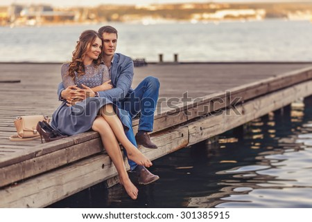 Young couple in love outdoor.Stunning sensual outdoor portrait of young stylish fashion couple posing in summer in street - stock photo