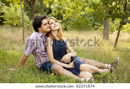 Young couple in love outdoors. - stock photo